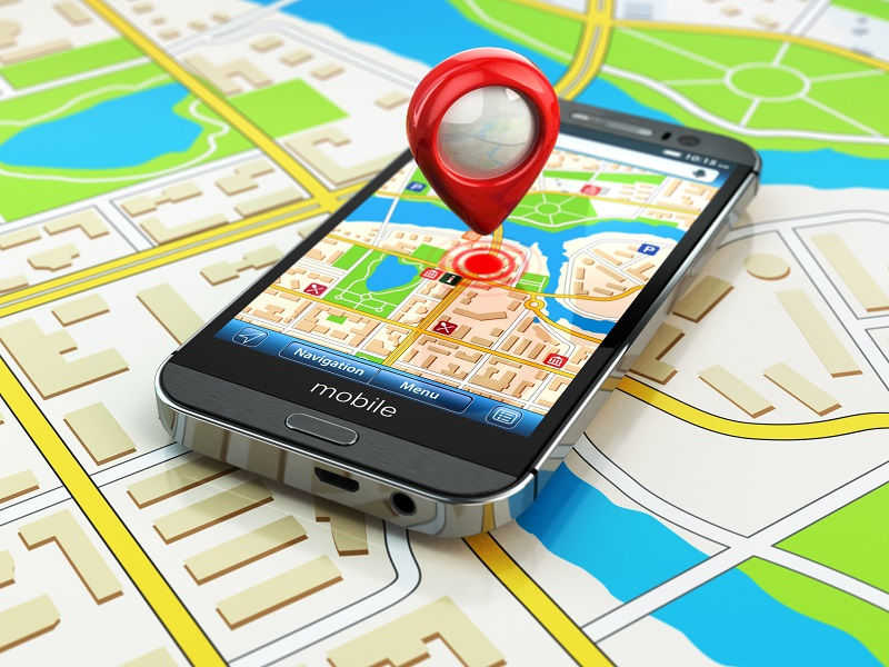 Mobile GPS navigation concept. Smartphone on map of the city,
